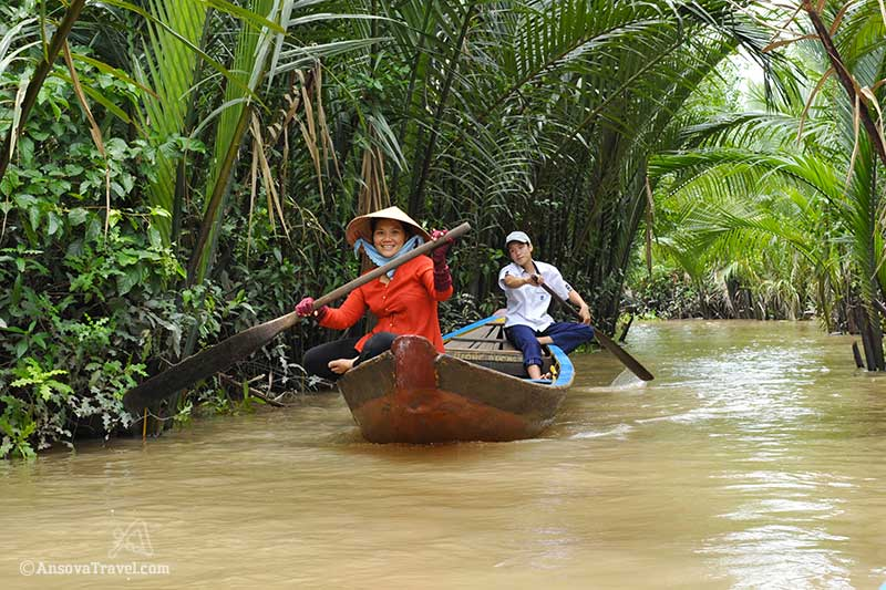 Rowing sampan in Mekong delta, Vietnam